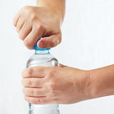 Hands opening a bottle of fresh water Royalty Free Stock Photo