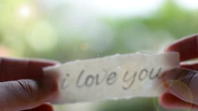 Hands opening love letter. Confession of love. Hands opening love letter. Bokeh background. Confession of love. Valentines day video stock video footage