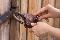 Hands opening the padlock Royalty Free Stock Images