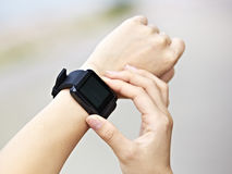 Hands operating a smart watch stock photography