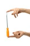 hands orange skruvmejsel två Arkivfoton