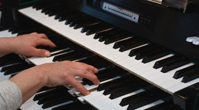 Hands on an organ keyboard Royalty Free Stock Photo