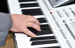 Hands on an organ keyboard Stock Image