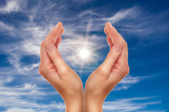 Hands over blue sky Stock Images