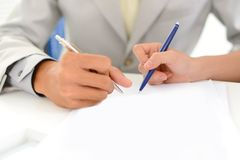 Hands over document Royalty Free Stock Photo