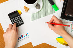 Hands over financial chart background. Hands over paper and financial chart background Royalty Free Stock Photo