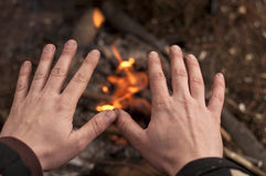 Hands over fire Royalty Free Stock Photos