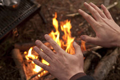 Hands over fire Royalty Free Stock Photo
