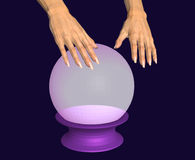 Hands over a glowing crystal ball. Stock Photo