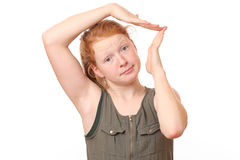 Hands over head. Portrait of a teenage girl with hands over head on white background Royalty Free Stock Photo
