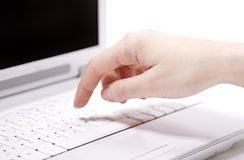 Hands over laptop Stock Image