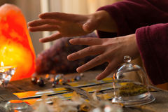 Hands over tarot cards. Fortune teller hands over tarot cards Royalty Free Stock Images