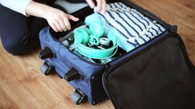 Hands packing travel bag with personal stuff. Tourism, people, luggage and clothing concept - hands packing travel bag with personal stuff stock video