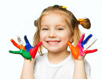 Hands in the paint. Beautiful little girl with her ??hands in the paint royalty free stock photos