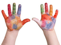 Hands in paint. Child is holding up painted art hands on a white isolated background stock photos