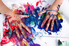 Hands in paint Stock Images