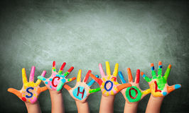 Hands Painted With Blackboard. Written School On The Hands stock photo