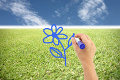 Hands are painted blue flowers. Stock Images