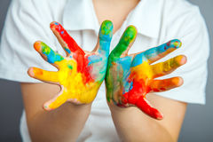 Hands painted  in colorful paints Royalty Free Stock Photography