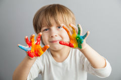 Hands painted  in colorful paints Stock Photography