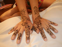 Hands painted with henna Stock Photo