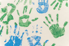 Hands painted. Stamped on paper, colorful fun. Creative, funny and artistic Stock Images