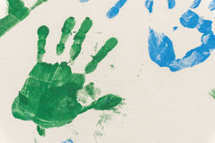 Hands painted, stamped on paper. Colorful fun. Creative, funny and artistic Stock Images