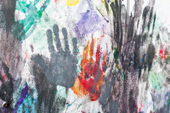Hands painted wall with finger prints Stock Image