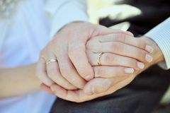 Hands of  pair with a beautiful wedding ring Royalty Free Stock Photos