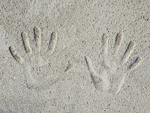 Hands palms imprints on concrete wall surface royalty free stock photos
