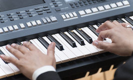 Hands Palying Electronic Piano Stock Photography