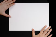 Hands and paper Royalty Free Stock Images