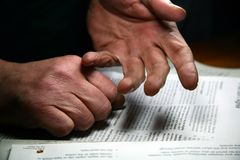 Hands and Paper. Hands over a paper stock image