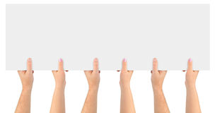 Hands and paper banner Royalty Free Stock Photography