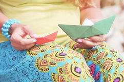 Hands with paper boats. Woman holding origami boats outdoors Royalty Free Stock Photo