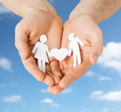 Hands with paper couple pictogram and heart shape Stock Images
