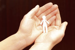 Hands with paper figure Stock Photo