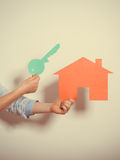 Hands and paper house. Housing real estate concept Royalty Free Stock Photos