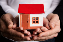Hands with paper house Royalty Free Stock Images