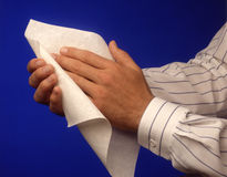 Hands with paper towel. Stock Images