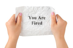 Hands and paper You Are Fired Royalty Free Stock Photo