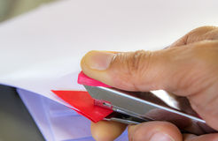 Hands with papers and stapler Stock Photography
