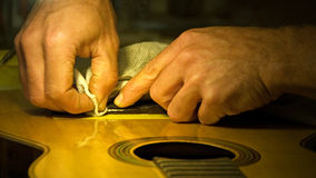 Hands of A Parisian Luthier. This shot was taken in low available light in a guitar repair shop in Paris Royalty Free Stock Image