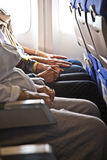 Hands of passengers in the cabin Royalty Free Stock Photo