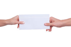 Hands passing letter envelope Stock Photos