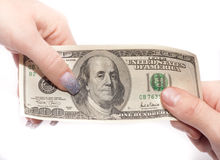 Hands passing money Royalty Free Stock Photo