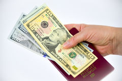 Hands, passport and currency Royalty Free Stock Photos