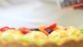 Hands pastry chef preparing a fruit tart stock footage