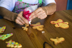 Hands pastry decorating Christmas cookies Stock Photos