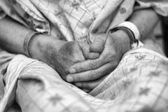 Hands of a patient praying. Hands of a patient from a hospital Royalty Free Stock Photos